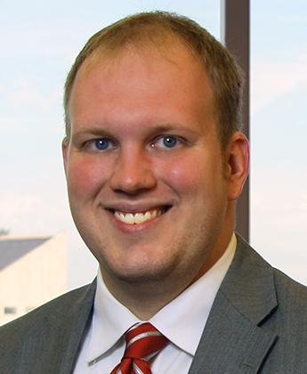 Adam M.  Law